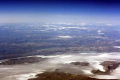 Alien earths series. A view on Greenland from the stratosphere: beautiful mountains, glaciers, mountain lakes, fjords, and on the top - blackness of space Royalty Free Stock Photography