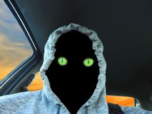 Alien eyes hoodie car driver royalty free stock photos