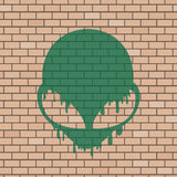 Alien face illustration in brick wall Royalty Free Stock Photography