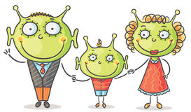 Alien family. With a little son Royalty Free Stock Images