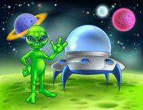 Alien and Flying Saucer on Moon Royalty Free Stock Photo