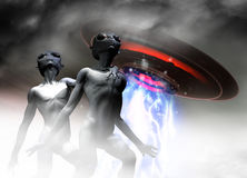 Alien Greys and UFO. Two alien greys are seen looking up at their own UFO which hovers above their heads Royalty Free Stock Photo