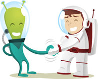 Alien handshake with astronaut cartoon. Humans and aliens meet at last, the first contact of the universe Stock Photos