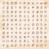 Alien hieroglyphics carved in stone. Royalty Free Stock Images