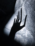 Alien horror hand. Eery shadow of a hand on a wall with varying fingerlenght ideal for an alien or horror topic creating a strange mood without being specific Royalty Free Stock Photography