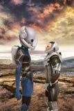 Alien and human astronauts encounter Stock Photo