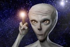 Alien. Humanoid with alighten finger Royalty Free Stock Photo