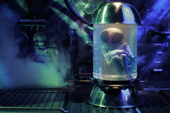 Alien inside a test tube Royalty Free Stock Photo
