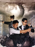 Alien invasion - destruction of a city. Three special agents against an alien invasion stock image