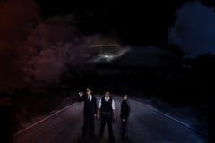 Alien invasion - three secret agents Stock Photography