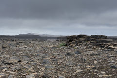 Alien landscape with dead rocks and heavy clouds, Iceland Royalty Free Stock Photography