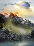 Alien landscape. Imaginary alien snowy landscape with two close planets visible behind the mountains stock photography