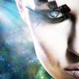 Alien look. Abstract female portrait against space backgrounds stock image