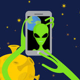 Alien makes selfie in space. Space alien takes pictures of herse Royalty Free Stock Photo