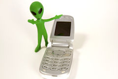 Alien Making Call Me Gesture with a Cell Phone Royalty Free Stock Images