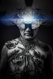 Alien, man chained with fantasy mask royalty free stock image