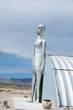 Alien in Nevada desert. RACHEL, NEVADA/USA – March 30, 2010: The tall metal Alien figure at the Alien Research Center located on Nevada's Extraterrestrial royalty free stock photos