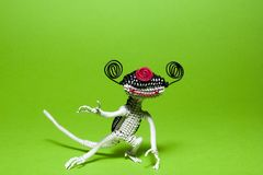 Alien pet posing on green background. royalty free stock images