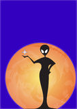 Alien and planet. Silhouetted alien figure with star and orange planet on blue background with copy space Stock Photography