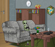 Alien Playing Video games. Bored alien playing console video games in a messy room Stock Photo