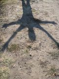 Alien Shadow Extends Over Parched Earthen Ground Royalty Free Stock Image
