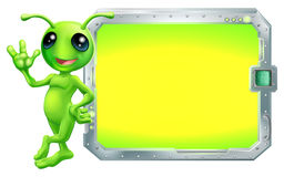 Alien with sign or screen. A cute green alien with a sign or screen with copyspace Royalty Free Stock Photography