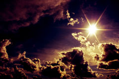 Alien sky with dramatic sun and clouds Stock Images