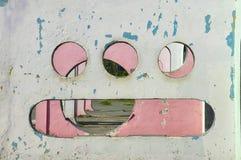 Alien smile. A wall in a park, Constanta, Romania Royalty Free Stock Photography