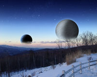 Alien space scene. Alien planet at sunrise or sunset with two moons in orbit rising. Sci-fi Fantasy artwork Royalty Free Stock Photography