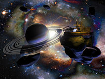 Alien space station. A space station constructed on an asteroid near  a planet similar to saturn, in a  galaxy far away Royalty Free Stock Image