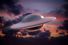 Alien spacecraft. Extraterrestrial spaceship flying over cloudy sky Stock Photography