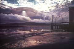 UFO arriving on beach vacation Royalty Free Stock Photo