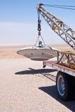 Alien Spacecraft on Tow Truck. A desert tow truck transports an alien space ship for repairs near Rachel Nevada stock photography
