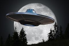 Alien spaceship UFO is flying at night. Moon in background.