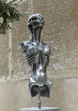 Alien statue outside the H.R. Giger Museum. Pictured is an interesting alien statue outside the H.R. Giger Museum in Gruyeres, Switzerland. Hans Rudolf Giger was royalty free stock image