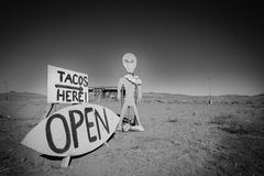 Alien and a Taco Shop SIgn. On the way to the black rock desert in Nevada, Black and White pitcure Stock Images