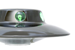 Alien in ufo. UFO with a green alien - Close-up of an UFO with a green alien, white background Stock Image
