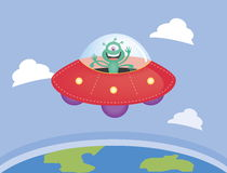 Alien and UFO  flying over the earth Stock Photos