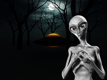 Alien And UFO In Forest. An alien and a UFO in a dark forest Royalty Free Stock Image
