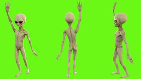 Alien waving his hand to greet. On green screen Stock Photography