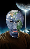 Alien World. A young man with a the earth as his head stock photos