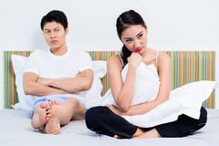 Alienated Chinese couple, woman is rejecting her man stock images