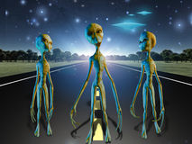 Aliens on country road. With their ships Stock Photos