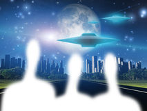 Aliens and ships outside city Stock Image