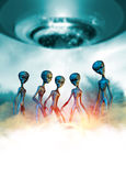 Aliens and UFO. Conceptual image of a group of five aliens greys in the mist below a large UFO Stock Photo