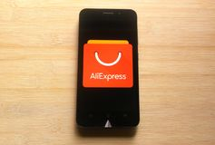 AliExpress. App on smartphone kept on wooden table royalty free stock photo