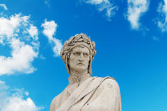 Alighieri statue under a blue sky with clouds Royalty Free Stock Images