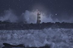 Alight beacon in a stormy sea at night. River mouth pier and alight beacon in a stormy sea at night stock image