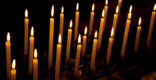 Alight candles. Over the black background Stock Images