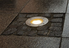 Alight lamp in pavement Stock Image